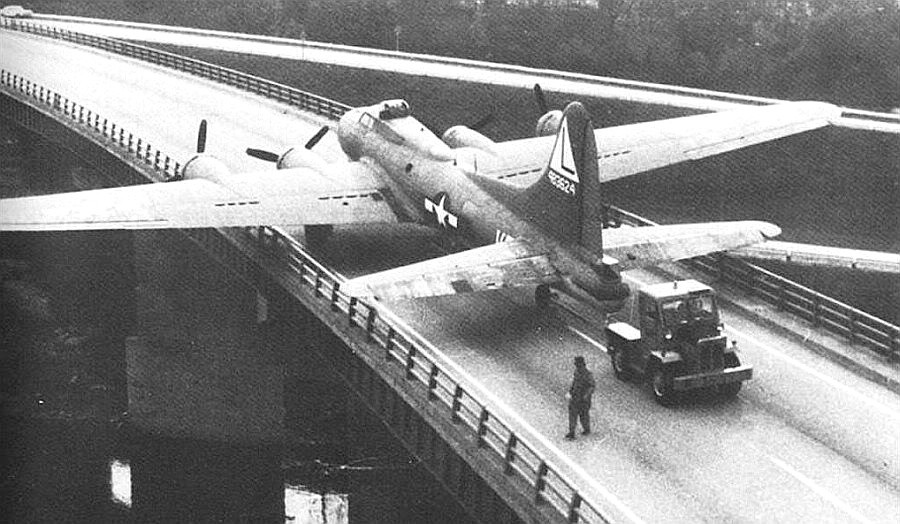 B17 bomber being towed across the bridge