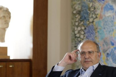 Greece's culture minister Nikos Xydakis listens a question during an interview with the Associated Press in Athens, Friday, May 15, 2015. Xydakis says he has not ruled out court action for the return of the ancient Parthenon Sculptures from the British Museum in London, but diplomacy still seems the most effective option. (AP Photo/Thanassis Stavrakis)