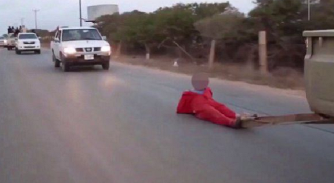 ISIS drags man to gruesome death behind a ute (warning: graphic pics