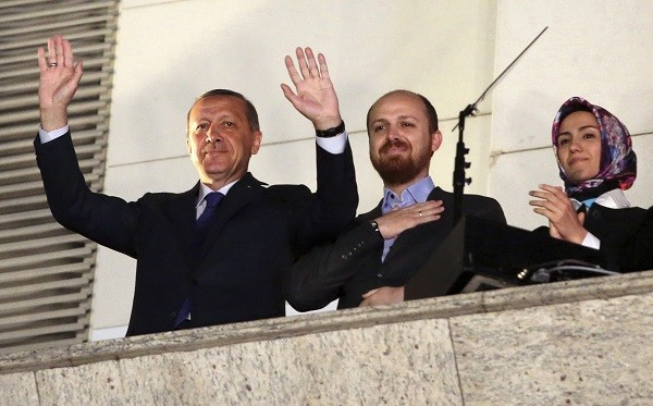 "Turkish Prime Minister Tayyip Erdogan (L), accompanied by his son Bilal and daughter Sumeyye, greets his supporters at the AK Party headquarters in Ankara March 30, 2014. Tayyip Erdogan declared victory in local polls that had become a referendum on his rule and said he would ""enter the lair"" of enemies who have accused him of corruption and leaked state secrets. ""They will pay for this,"" he said. Erdogan spoke from a balcony at his AK Party headquarters to thousands of cheering supporters as early results showed it winning some 44-46 percent of the vote, and the opposition CHP trailing with 23-28 percent. Picture taken March 30. REUTERS/Umit Bektas (TURKEY - Tags: POLITICS ELECTIONS)"
