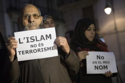BARCELONA, SPAIN - NOVEMBER 16: Muslims from Barcelona gather to condemn Friday terror attacks in Paris by holding posters at Placa Sant Jaume in Barcelona, Spain on November 16, 2015. (Photo by Albert Llop/Anadolu Agency/Getty Images)