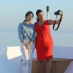 Kim Kardashian shows off her pregnancy bump in a tight red dress on board a yacht with Kourtney Kardashian in Greece during their family vacation. Kim had been sightseeing in the Agean sea along with the rest of the group and even laughed while pointing out the fans looking at them as they filmed their reality show.   Pictured: Kim Kardashian and Kourtney Kardashian Ref: SPL534013  280413   Picture by: DFWM/ Brian Prahl / Splash News  Splash News and Pictures Los Angeles:	310-821-2666 New York:	212-619-2666 London:	870-934-2666 photodesk@splashnews.com