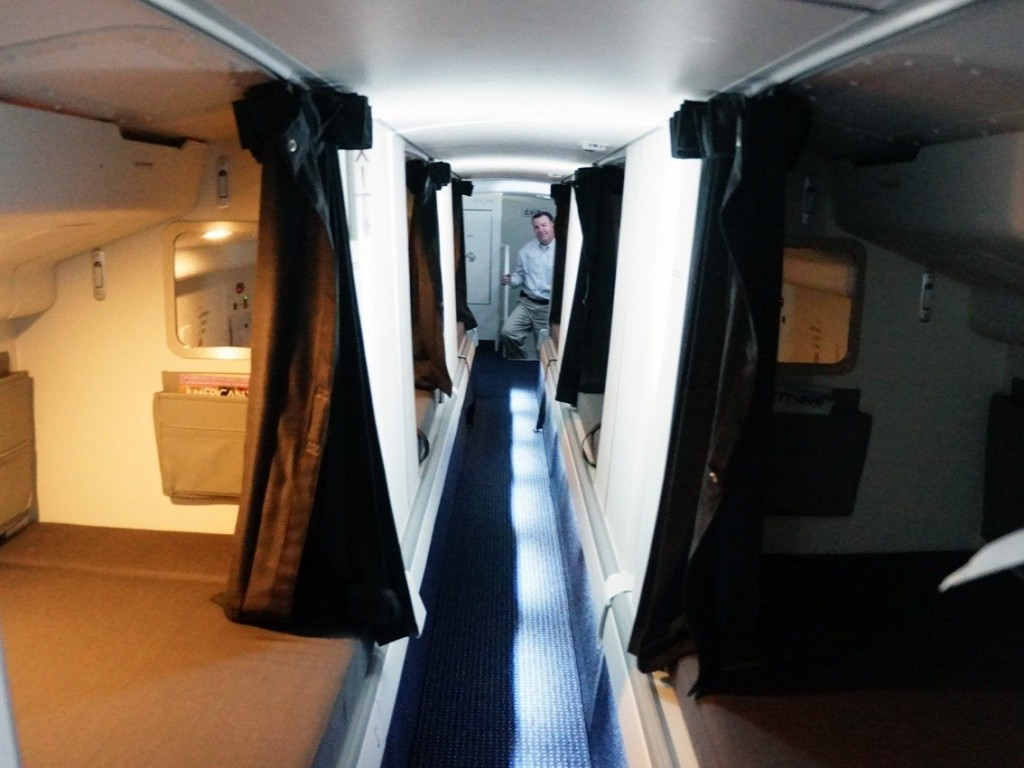 other-planes-like-this-american-airlines-boeing-773-have-partitioned-off-beds-along-an-aisle-reminiscent-of-a-cruise-ship-the-aisle-is-so-low-that-you-have-to-duck-to-walk-through-it