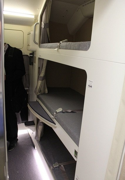 others-have-bunk-beds-that-are-stacked-on-top-of-each-other-like-this-malaysian-air-a380-plane