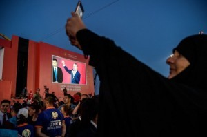 A woman takes pictures of Turkish President on August 7, 2016 in Istanbul during a rally against the failed military coup on July 15.  Hundreds of thousands of people gathered in Istanbul for a pro-democracy rally organised by the ruling party, bringing to an end three weeks of demonstrations in support of President Recep Tayyip Erdogan after last month's failed coup.  / AFP PHOTO / OZAN KOSE
