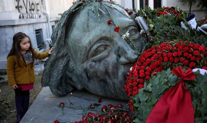 A girl stands next to a monument inside the Athens' Polytechnic school, on the 43rd anniversary of a 1973 student uprising against the then military ruling junta in Athens, Greece, November 17, 2016. REUTERS/Alkis Konstantinidis