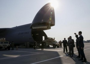 The first plane from the United States with non-lethal aid, including ten Humvee vehicles, is seen at Borispol airport near Kiev, March 25, 2015. REUTERS/Gleb Garanich