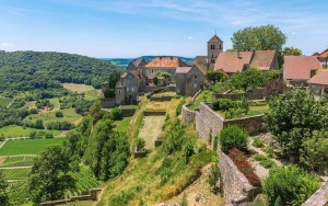 View of the picturesque medieval village in valley. Chalon, Departement Jura, Franche-Comte, France