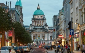 Facade of the Baroque Revival 'Belfast City Hall' the civic building of Belfast City Council illuminated at dusk in Belfast City Centre