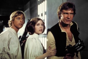 No Merchandising. Editorial Use Only. No Book Cover Usage. Mandatory Credit: Photo by Lucasfilm/20th Century Fox/REX/Shutterstock (5886297bq) Mark Hamill, Carrie Fisher, Harrison Ford Star Wars Episode IV - A New Hope - 1977 Director: George Lucas Lucasfilm/20th Century Fox USA Scene Still Scifi Star Wars (1977) La Guerre des étoiles