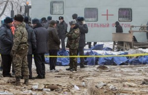 ATTENTION EDITORS - VISUAL COVERAGE OF SCENES OF INJURY OR DEATHMembers of rescue teams are seen next to body bags with victims at the crash site of a Turkish cargo jet near Kyrgyzstan's Manas airport outside Bishkek, January 16, 2017.  REUTERS/Vladimir Pirogov