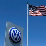 FILE PHOTO - A U.S. flag flutters in the wind above a Volkswagen dealership in Carlsbad, California, U.S. May 2, 2016.  REUTERS/Mike Blake/File Photo