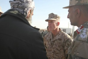Vice Admiral Robert S. Harward, commanding officer of Combined Joint Interagency Task Force 435, greets an Afghan official during his visit to Zaranj, Afghanistan, January 6, 2011.  Photo courtesy of Sgt. Shawn Coolman/Department of Defense/Handout via REUTERS