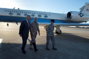 Then U.S. Secretary of Defense Chuck Hagel (L), walks with Vice Admiral Robert Harward (C) and Colonel Kelly Martin, vice commander of 6th Air Mobility Wing, after landing at MacDill Air Force Base, Tampa, Florida, U.S., March 21, 2013.   Courtesy Erin A. Kirk-Cuomo/Department of Defense/Handout via REUTERS