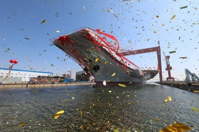 China's second aircraft carrier, first domestically built aircraft carrier, is seen during its launching ceremony in Dalian, Liaoning province, China, April 26, 2017. REUTERS/Li Gang/Xinhua ATTENTION EDITORS - THIS PICTURE WAS PROVIDED BY A THIRD PARTY. THIS PICTURE IS DISTRIBUTED EXACTLY AS RECEIVED BY REUTERS, AS A SERVICE TO CLIENTS. EDITORIAL USE ONLY. NO RESALES. NO ARCHIVE. CHINA OUT. NO COMMERCIAL OR EDITORIAL SALES IN CHINA.