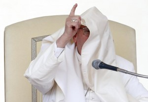 A gust of wind blows Pope Francis' mantle during his Wednesday general audience in Saint Peter's square. REUTERS/Tony Gentile