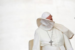 A gust of wind blows off Pope Francis' mantle during the weekly audience in Saint Peter's Square at the Vatican.  REUTERS/Tony Gentile