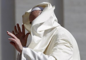A gust of wind blows Pope Francis' mantle as he arrives to lead his Wednesday general audience in Saint Peter's Square at the Vatican. REUTERS/Max Rossi