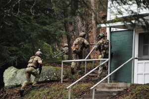 Estonian Special Operations Force soldiers, along with U.S. Army Special Operations Forces Soldiers with 10th Special Forces Group (Airborne) and soldiers of the West Virginia National Guard, quickly move to assault a building containing high-value adversary targets during an air-assault training exercise as part of Exercise Ridge Runner Feb. 23, 2017 in West Virginia. Ridge Runner is an exercise hosted by the West Virginia National Guard involving U.S. and NATO special operations forces focused on unconventional warfare. (U.S. Army photo by Sgt. 1st Class Jeff Smith)