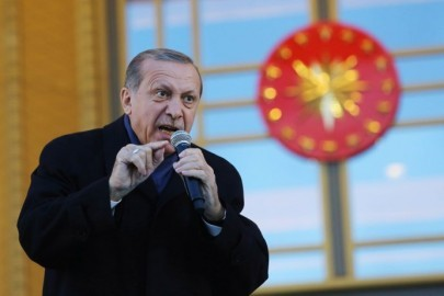 "ANKARA, TURKEY - APRIL 17: Turkish President Tayyip Erdogan gives a referendum victory speech to his supporters at the Presidential Palace on April 17, 2017 in Ankara Turkey. Erdogan declared victory in Sunday's historic referendum that will grant sweeping powers to the presidency, hailing the result as a ""historic decision. 51.4 per cent per cent of voters had sided with the ""Yes"" campaign, ushering in the most radical change to the country's political system in modern times.Turkey's main opposition calls on top election board to annul the referendum. OSCE observers said that a Turkish electoral board decision to allow as valid ballots that did not bear official stamps undermined important safeguards against fraud. (Photo by Elif Sogut/Getty Images)"