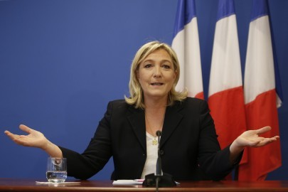France's National Front political party head Marine Le Pen gestures as she speaks during a news conference at the party headquarters in Nanterre near Paris February 6, 2015.  REUTERS/Charles Platiau  (FRANCE - Tags: POLITICS) - RTR4OI2A