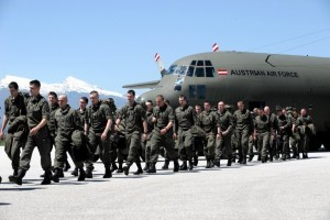 """Members of the Austrian NATO Kosovo forces (KFOR) arrive at a military airport near the town of Gjakova on April 27, 2012.  NATO has started deploying extra troops in Kosovo to prevent unrest in its ethnically tense north ahead of elections in neighboring Serbia on May 6.  """"The deployment will be scheduled until Monday,"""" NATO led mission (KFOR) spokesman Marc Stummler told reporters. AFP PHOTO/ARMEND NIMANI / AFP PHOTO / ARMEND NIMANI"""