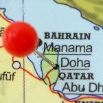 FDG3A1 Close-up of a red pushpin in a map of Doha, Qatar.