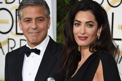 Actor George Clooney (L) and Amal Clooney arrive on the red carpet for the 72nd annual Golden Globe Awards, January 11, 2015 at the Beverly Hilton Hotel in Beverly Hills, California.               AFP PHOTO/MARK RALSTON        (Photo credit should read MARK RALSTON/AFP/Getty Images)