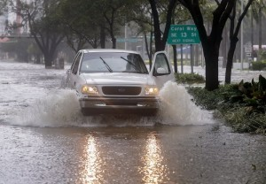 epa06197197 A pickup truck drives through the storm surge flood waters along Brickell Avenue after the full effects of Hurricane Irma struck in Miami, Florida, USA, 10 September 2017. Many areas are under mandatory evacuation orders as Irma Florida.  EPA/ERIK S. LESSER