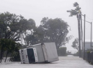 epa06197204 A toppled box truck after the full effects of Hurricane Irma struck in Miami, Florida, USA, 10 September 2017. Many areas are under mandatory evacuation orders as Irma Florida.  EPA/ERIK S. LESSER