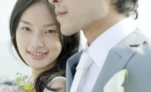 Japanese bride smiling next to groom