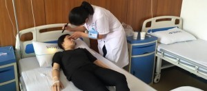 "Pics shows: The gir at hospital;  Doctors say a woman's partial blindness was brought on by excessive tiredness after she sought medical help because she had played smartphone games for an entire day and could no longer see out of one eye.  Wu Xiaojing, 21, says she can no longer see from her right eye after a day of gaming on her device from her home in Chang'an city in north-western China's Shaanxi Province.  The trainee accountant says she stopped gaming for dinner, only to have her eyesight dim then go in her right eye.  She rushed to hospital where doctors diagnosed her with a condition named retinal artery occlusion, a disease that is usually caused by tiredness of the eye.  Wu said playing games on her phone is her ""only hobby"", with the mobile device taking all of her spare hours after work and at weekends.  The obsessed gamer says at the weekend, she hardly goes anywhere and will instead stay home to play games.  She said a typical day sees her gets up around 6:30am and begins to play the game after having breakfast.  She said she then does not stop until around 4pm when she has a late lunch, then a nap then games once she wakes until 2am in the morning.  Wu remains in hospital under doctor care.  It is not known if her eyesight will return."