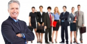 Businessman and a large group of young smiling business people