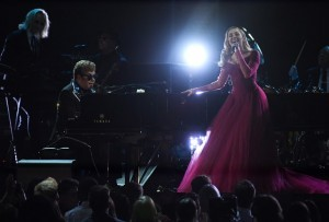 Sir Elton John (L) and Miley Cirus perform during the 60th Annual Grammy Awards show on January 28, 2018, in New York.  / AFP PHOTO / Timothy A. CLARY