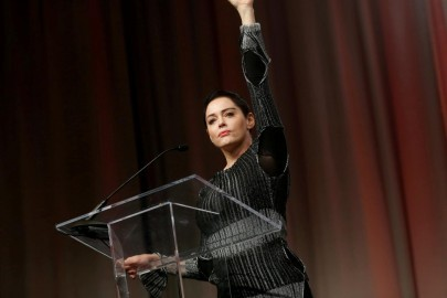 FILE PHOTO: Actor Rose McGowan raises her fist after addressing the audience during the opening session of the three-day Women's Convention at Cobo Center in Detroit, Michigan, U.S., October 27, 2017. REUTERS/Rebecca Cook/File Photo