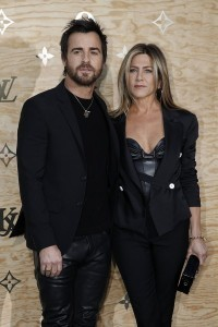 epa05903529 US actress Jennifer Aniston and US actor Justin Theroux arrives at the launch party by French fashion house Louis Vuitton of a new line of bags and accessories created by US artist Jeff Koons at the Louvre Museum in Paris, France, 11 April 2017. It is the first stage of Vuitton collaboration with Koons. Famous paintings works by Da Vinci, Titian, Rubens, Fragonard and Van Gogh have been transposed onto the canvas of bags.  EPA/YOAN VALAT