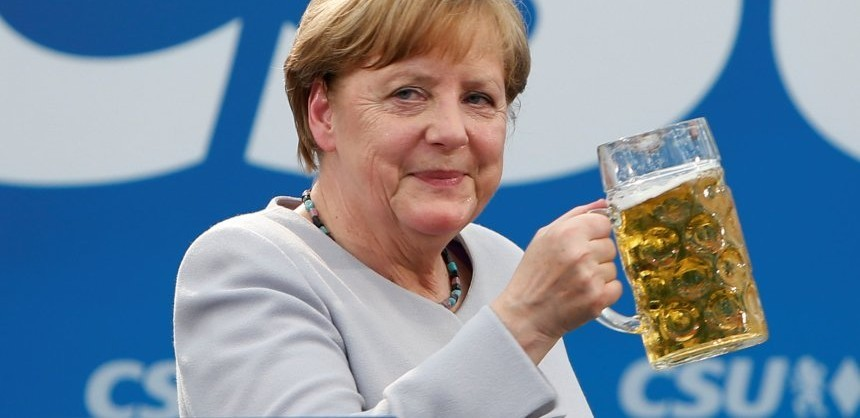 German Chancellor and head of the Christian Democratic Union (CDU) Angela Merkel toasts during the Trudering festival in Munich, Germany, May 28, 2017.    REUTERS/Michaela Rehle