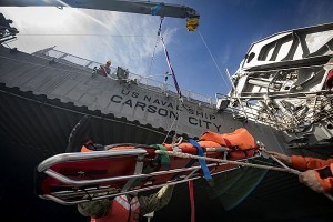 180303-N-JI086-217  IONIAN SEA (March 3, 2018) Sailors and civilian mariners assigned to the Spearhead-class expeditionary fast transport ship USNS Carson City (T-EPF 7) participate in a medical evacuation drill in the Ionian Sea. Carson City is conducting naval operations in the U.S. 6th Fleet area of operations to advance security and stability in the region. (U.S. Navy photo by Mass Communication Specialist 3rd Class Ford Williams/Released)