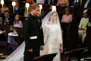 Britain's Prince Harry, Duke of Sussex (L) and US fiancee of Britain's Prince Harry Meghan Markle stand together for their wedding in St George's Chapel, Windsor Castle, in Windsor, on May 19, 2018. / AFP PHOTO / POOL / Dominic Lipinski