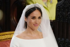 US fiancee of Britain's Prince Harry, Meghan Markle arrives at the High Altar for their wedding ceremony in St George's Chapel, Windsor Castle, in Windsor, on May 19, 2018. / AFP PHOTO / POOL / Jonathan Brady