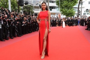 "Russian model Irina Shayk poses as she arrives on May 10, 2018 for the screening of the film ""Sorry Angel (Plaire, Aimer et Courir Vite)"" at the 71st edition of the Cannes Film Festival in Cannes, southern France.  / AFP PHOTO / Valery HACHE"
