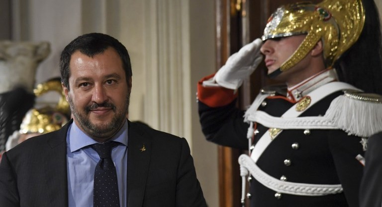 """Matteo Salvini, leader of the far-right party """"Lega"""" (League) speaks to the press after a meeting with Italian President Sergio Mattarella as part of consultations of political parties to form a government, on May 14, 2018 at the Quirinale palace in Rome.  The leaders of the anti-immigrant League party and anti-establishment Five Star Movement meet the Italian president today to share details of a coalition government programme three month after general elections in Italy.  / AFP PHOTO / ANDREAS SOLARO"""