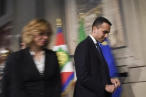 Anti-establishment Five Star Movement (M5S) leader Luigi Di Maio (R) and Giulia Grillo, president of the M5S group at the Parliament, leave after a meeting with Italian President Sergio Mattarella as part of consultations of political parties to form a government, on May 14, 2018 at the Quirinale palace in Rome.  The leaders of the anti-immigrant League party and anti-establishment Five Star Movement meet the Italian president today to share details of a coalition government programme three month after general elections in Italy.  / AFP PHOTO / ANDREAS SOLARO