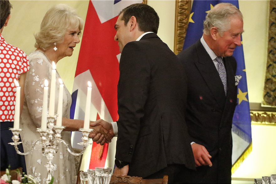 Photos from official dinner for Prince Charles and Camilla