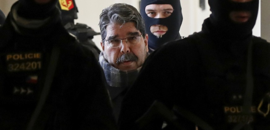 Syrian Kurdish leader Saleh Muslim (C) is escorted by Czech police for his trial at the municipal court on February 27, 2018 in Prague. A Czech court released Muslim, who was detained at the weekend and is wanted by Turkey on terror charges, his lawyer said. The former leader of the Syrian Kurdish Democratic Union Party (PYD) is still a figurehead for Kurds in Syria. / AFP PHOTO / Stringer / ALTERNATIVE CROP         (Photo credit should read STRINGER/AFP/Getty Images)