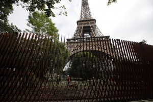 View of a new metal barrier under construction around the Eiffel Tower in Paris, France, Thursday, June 14, 2018. Paris authorities have started replacing the metal security fencing around the Eiffel Tower with a more visually appealing glass wall. The company operating the monument said see-through panels are being set up instead of the fences at the north and south of the famed monument that were installed for the Euro 2016 soccer event. Each panel is 3 meters high, over 6 centimeters thick and weighs 1.5 ton. (AP Photo/Francois Mori)